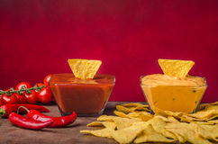 Tortilla chips with two dips. Chilli hot and cheese dip Stock Photography
