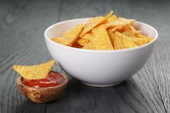 Tortilla chips in white bowl with tomato sauce on Royalty Free Stock Photos