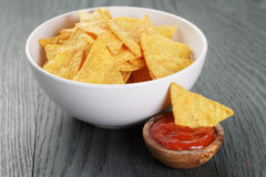 Tortilla chips in white bowl on wooden table Royalty Free Stock Photography