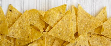 Tortilla chips on white wooden surface, top view. Mexican food stock photography