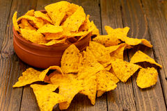 Tortilla chips on wooden table Royalty Free Stock Image