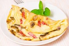 Tortilla con las setas y el salami Imagenes de archivo