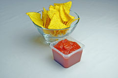Tortilla crisps and salsa dip Stock Photos