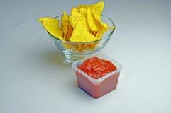 Tortilla crisps and salsa dip Stock Photos