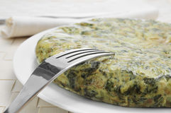 Tortilla de espinacas, spanish spinach omelette Royalty Free Stock Images