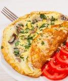 Tortilla de huevos con las setas y el queso Fotografía de archivo libre de regalías