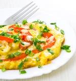 Tortilla de huevos con los tomates Imagen de archivo