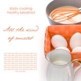 Tortilla de huevos que hace en color anaranjado Fotos de archivo libres de regalías