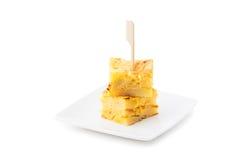Tortilla de patatas. Spanish tapas. Tortilla de patatas toothpick  on white backround Stock Photography