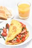 Tortilla del huevo con las verduras y el jamón Imagen de archivo libre de regalías