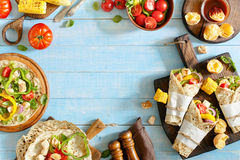 Tortilla with grilled chicken fillet and different vegetables royalty free stock photo