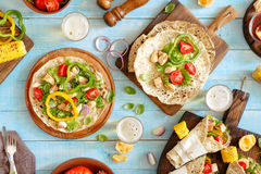 Tortilla with grilled chicken fillet, lager and grilled vegetabl Stock Photos