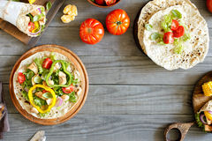Tortilla with grilled chicken fillet and vegetables stock images