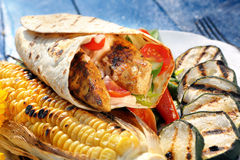 Tortilla with grilled chicken and vegetables Stock Image