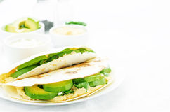 Tortilla with hummus, avocado, feta and parsley Royalty Free Stock Photo