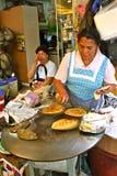 Tortilla maker, Mexico. Mexican woman preparing fresh handmade corn tortillas Stock Photography