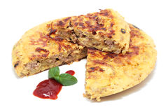 Tortilla of minced meat. With onion and zucchini isolated Royalty Free Stock Photography