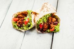 Tortilla with mincemeat and beans. On a wooden table Stock Images