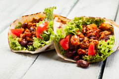 Tortilla with mincemeat and beans. On a wooden table Stock Photo