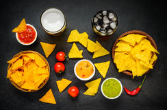Tortilla Nacho Chips with Drinks and Dip Royalty Free Stock Image