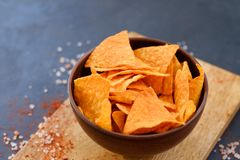 Tortilla nacho chips recipe natural fried crisps. Tortilla nacho chips recipe. natural fried crisps in a bowl on dark background stock image