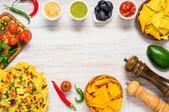 Tortilla Nachos in Copy Space Frame with Ingredients Stock Photo