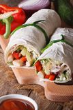 Tortilla roll with chicken, vegetables closeup vertical Royalty Free Stock Photography