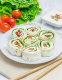 Tortilla roll with soft cheese, chicken ham, and vegetable. Closeup Stock Images