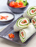 Tortilla roll with soft cheese, chicken ham, and vegetables. Closeup Royalty Free Stock Image