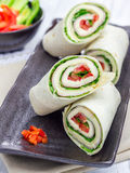 Tortilla roll with soft cheese, chicken ham, and vegetables Royalty Free Stock Photos