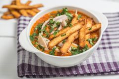 Tortilla soup with chicken. The national dish of Mexican cuisine. The view from the top. Copy-space. royalty free stock photography