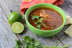 Tortilla Soup with Chips, fresh lime and cilantro Royalty Free Stock Photo
