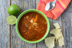 Tortilla Soup with Chips, fresh lime and spoon Royalty Free Stock Images