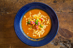 Tortilla Soup. Looking down at a rustic bowl of tortilla soup on a wood table Stock Image
