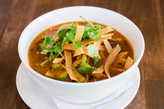 Tortilla Soup. On wooden surface Stock Image