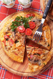 Tortilla, spanish omelette with mushrooms and tomato. Tortilla, spanish omelet with mushrooms, potato and vegetables Royalty Free Stock Image