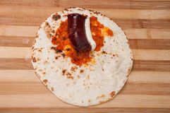 Tortilla stuffed with homemade sausage, tartar sauce and chutney Royalty Free Stock Image