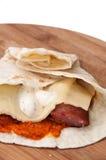 Tortilla stuffed with homemade sausage, tartar sauce and chutney Royalty Free Stock Photo