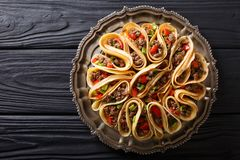 Tortilla stuffed with meat beef, peppers and onions closeup. Horizontal top view. Tortilla stuffed with meat beef, peppers and onions closeup on a table royalty free stock photography
