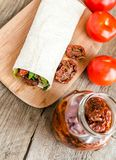 Tortilla with sun dried tomatoes. And greens Royalty Free Stock Images