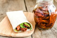 Tortilla with sun dried tomatoes. And greens Royalty Free Stock Image