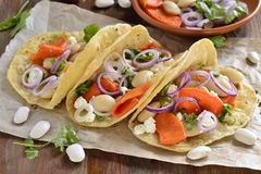 Tortilla, tacos with vegetables: pumpkin, white beans, goat cheese, onions Stock Images
