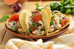 Tortilla, tacos with vegetables: pumpkin, white beans, goat cheese, onions Royalty Free Stock Image