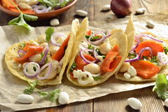 Tortilla, tacos with vegetables: pumpkin, white beans, goat cheese, onions Royalty Free Stock Images