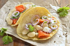 Tortilla, tacos with vegetables: pumpkin, white beans, goat cheese, onions Stock Image