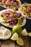 Tortilla with tuna, sesame, corn, cabbage and avocado close-up. stock photo