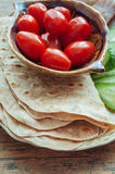 Tortilla with tuna and vegetables. On wooden table Stock Images