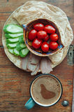 Tortilla with tuna and vegetables. On wooden table Royalty Free Stock Photo