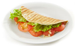 Tortilla with vegetables and cheese Royalty Free Stock Photo