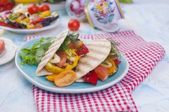 Tortilla with vegetables and salmon. Fitness food. Healthy lunch. Vegetables and fish. Summer menu. Diet, stock image